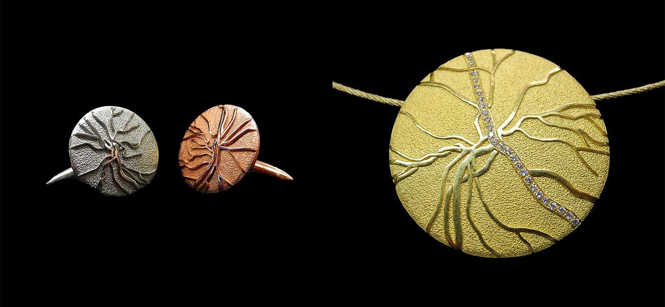 retina-manschetten-kettenanhaenger-ohrringe-gelbgold-platin-mit-retinamuster-speziell-individuell